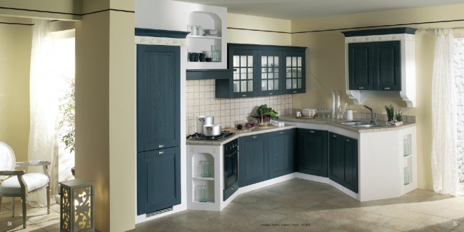 Matching wall color with dark blue kitchen cabinets