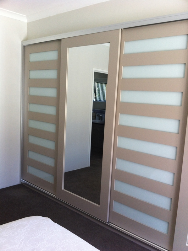 sliding door with mirror and inserts
