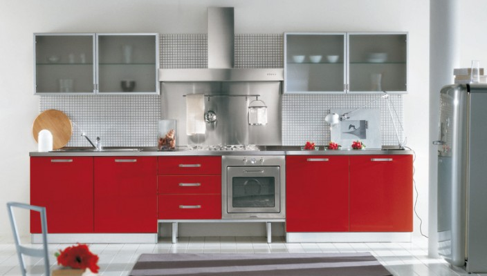 Use red and printed glass-front cabinets in your kitchen for a timeworn look